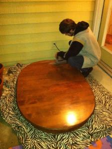 The boyfriend sanding the table- I have no problems with power tools, but we borrowed the sander from his grandpa. I figured it was better for him to break it than me.